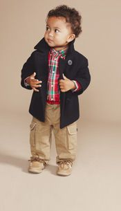 A toddler boy wearing a stylish peacoat.