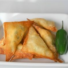 Jalapeno Puffs   Allrecipes.com Another version of Jalapeno Poppers - 1 (8 ounce) package cream cheese, softened 1 cup shredded Monterey Jack cheese 1 (4 ounce) can diced jalapeno peppers 2 cloves garlic, pressed 3 green onions, diced 1 (16 ounce) package wonton wrappers