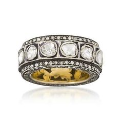 Uniqueness at its best! The white rose-cut and round natural diamonds are wonderfully arranged in a 3-band pattern to delightful effect. 14kt yellow gold and sterling silver with black rhodium ring.