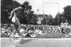 Quad Day 1970  Man rides unicycle on
