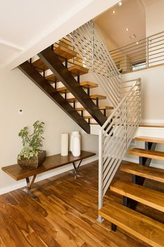 good use of space in a stairwell. like the wood steps too