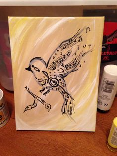 Song bird painted on a small canvas using music notes and musical symbols
