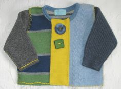 Baby and childrens clothing, made out of soft recycled wool and cashmere sweaters. The sweaters are boiled (felted), cut apart and then reassembled. Each sweater is unique and entirely made by hand with much attention to detail.    This cardigan is all about color and shapes. Hues of green, grey and blue are combined with bright yellow in this little piece of wearable art. the sweater closes with snaps and is embellished with two large buttons (one vintage, the square one ceramic made by…