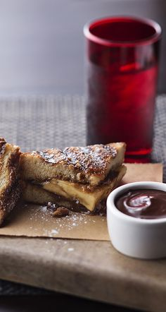Banana Toffee Panini. Take ripe bananas and toffee pieces and bress between cinnamon-sugar brioche bread. Drizzle with dulce de leche and enjoy at Michael's Genuine Pub.