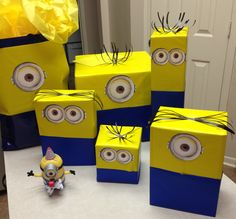 Minion wrapping for my minion loving hubby!  99 cent rolls of blue & yellow paper from Party City, black ribbon and printed eyes...big impact for just a little cash!