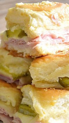 Cuban Sliders Recipe ~ These sliders are loaded with ham, swiss cheese, and dill pickles, topped with a dijon mustard onion spread! Super easy to make and definitely a crowd pleaser!!