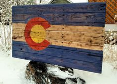 "Colorado flag from reclaimed oak. Flag isready to hang and measures approximately 40"" x 24""."