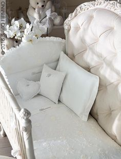 The authentic, original design of the cots by NOTTE FATATA by Savio Firmino welcome the Blumarine Baby kits of bed linen, bedcover and bumper which feature embroidered roses and Swarovski crystals.