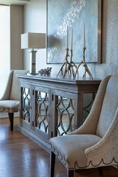 Buckingham Interiors: Beautiful reclaimed wood and mirror paneled buffet cabinet. Abstract art, polished ... - elegant decor