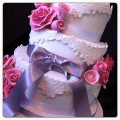 White lace and rose wedding cake