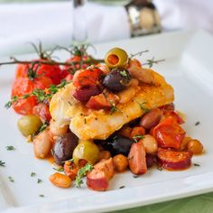 Baked Cod with 5 Beans and Chorizo ~ If you're trying to eat more fish, this baked cod recipe is a delicious way to do it because it balances healthy fish and beans with spicy chorizo sausage.