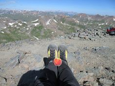 """""""I wore my SOMs to climb Handies Peak yesterday and was pleased with how they did on the trail. I loved how lightweight they are and how my toes aren't jammed into the front of my shoes on the descent. I'm sending you a photo of my SOMs and a Palisade peach on Handies Peak, two of my favorite Western Slope products."""" P.S. - Grand Junction, CO"""