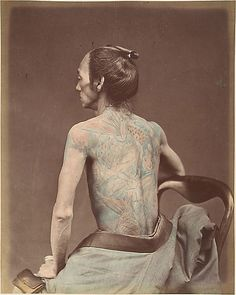 """An incredible shot from the Metropolitan Museum of Art, an Albumen silver print from a glass negative from the 1870's of a man with some traditional tattooing. Not much is known about this photograph but it is inscribed in pencil on mount, recto BC: """"Mechanic Tatooing"""" and is part of the Gilman Collection of the Museum. A great little slice of history."""