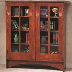 Stickley Harvey Ellis Bookcase with doors and inlay detail: perfect for the collector's editions in your library or office. Bookcase With Glass Doors, Craftsman Furniture, Stickley, Bookcase, Bookcase Storage, Bookcases For Sale, Furniture Instructions, Craftsman Style Furniture, Wood Bookcase