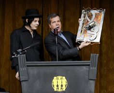 Music artist Jack White, left, received the first ever Music City Ambassador Award from Nashville Mayor Karl Dean, right, during a news conference at Third Man Records, Saturday, April 16, 2011, in Nashville, Tenn. (AP Photo/Donn Jones)