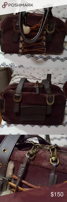 Get ready for winter! Ugg Purple bag This bag is a deep purple leather and suede great with your Ugg Boots and a sweater! It is in great pre-loved condition. With adorable fur tassles it will be one of your favs!!!!! UGG Bags Satchels