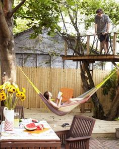 another great backyard. hammocks, decks, and treehouses.