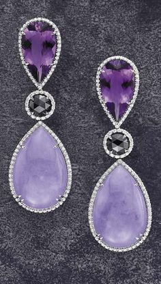 MARGHERITA BURGENER A Pair of Amethyst and Lavendar Jade-Jadeite Earpendants  Each surmount designed as an inverted pear-shaped amethyst within a pavé-set diamond surround to the similarly set circular-cut black diamond, suspending a pear-shaped cabochon purple jadeite drop within a pavé-set diamond surround, mounted in 18K white gold.