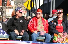 3 vets enjoy the crow from their float!