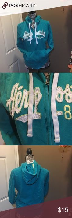 Aeropostale hoodie. Turquoise white and yellow hoodie in excellent used condition zipper works great no holes or staining. Aeropostale Tops Sweatshirts & Hoodies