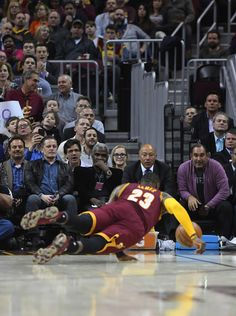 LeBron James Photos Photos - Cleveland Cavaliers owner Dan Gilbert and former NBA player Charles Oakley watch LeBron James #23 of the Cleveland Cavaliers dive for the ball during the first half against the New York Knicks at Quicken Loans Arena on February 15, 2017 in Cleveland, Ohio. NOTE TO USER: User expressly acknowledges and agrees that, by downloading and/or using this photograph, user is consenting to the terms and conditions of the Getty Images License Agreement. - New York Knicks v…
