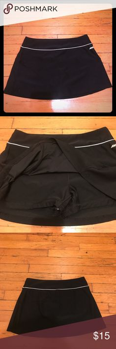 Avia Tennis Skirt Item: Tennis Skirt with built in shorts Color: Black and white trim Material: BODY- 88% Polyester 12% Spandex/ LINING- 100% Polyester Measurements: Size Small; Length is 11.5 Inches Brand: Avia Avia Skirts