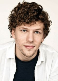 If you have hair like Jesse Eisenberg's naturally thick and curly hair, you can achieve a fuss-free style with the right cut | Curly Hair Ideas For Guys