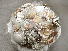 I want to make a brooch bouquet so badly.  Mine would be a little more vibrant though.  :)
