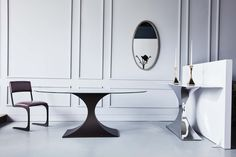Stunning silhouettes at our London showroom - the Capricorn dining and console table, plus Angel chair