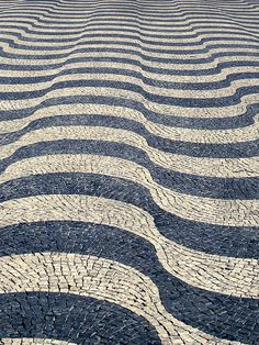 Portuguese pattern pavement in Pedro IV/ Rossio Square, Lisbon, Portugal... Select image to see more.