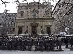 State troopers stand at attention outside the church. (Photo: Robert Deutsch, USA TODAY)