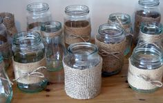 Jam Jars are really popular for wedding tables and can be decorated in lots of differant ways ... i love hessian and string for a rustic look x