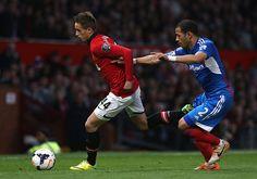 Adnan Januzaj moves past Hull City's Liam Rosenior in the 2013/14 season