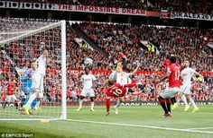 Acrobat: Rooney slams home United's equaliser with an overhead kick from Juan Mata's corner