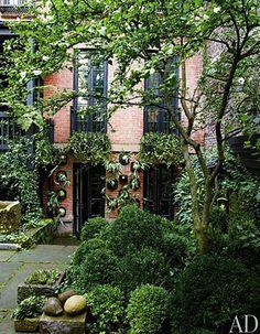 Julianne Moore's outdoor garden - Architectural Digest Boxwoods, ivy, stone, brick, courtyard