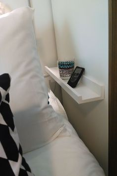 No space for a nightstand? Try a RIBBA picture ledge. -guest room.