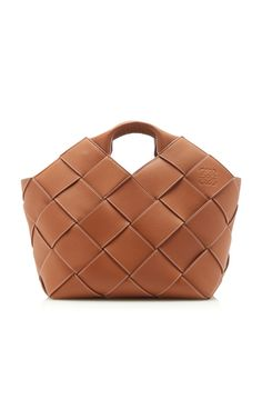This **Loewe** tote features a leather woven construction and dual top handles.