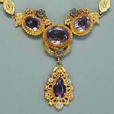 An early 19th century amethyst and gold necklace and pair of pendant earrings,