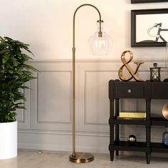 "Three Posts™ Manford 32"" Wide Genuine Leather Round Storage Ottoman & Reviews   Wayfair Tree Floor Lamp, Arc Floor Lamps, Brass Floor Lamp, Brass Lamp, Brass Metal, Arc Lamp, Etagere Bookcase, Decoration Inspiration, Decor Ideas"