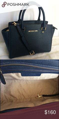 Michael Kors Medium Selma Leather Sathel Lightly used! Michael Kors medium selma leather satchel in navy. Sign of use in bottom hardware. Comes with long shoulder strap and can be used as crossbody. 100% Authentic! Michael Kors Bags Satchels