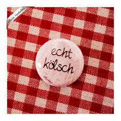 kölscher Button