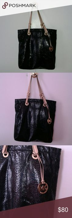 "[[  S O L D !!  ]] AUTHENTIC MICHAEL KORS PURSE This is an authentic Michael Kors shoulder bag . It is immaculate black & of pretty snake skin-like material ; This bag is alot more beautiful in person ! Contains the signature gold ""MK"" charm and multiple pockets inside . This bag  has been used for a few months yet remains in EXCELLENT condition .   OPEN TO REASONABLE OFFERS ONLY !    I DO NOT DO TRADES !  Michael Kors Bags Shoulder Bags"