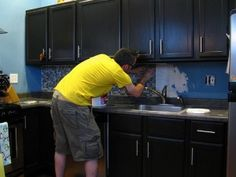10 DIY tips for a budget kitchen makeover: install tile backsplash, paint walls or cabinets, update cabinet hardware and faucet, add windowsill herb garden, add new window treatments