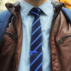 Light Blue @hm Shirt, Blue Striped Skinny Tie, Blue Tie Bar from @thetiebar, Brown @guess Leather Jacket, Navy Blue @herschelsupply Canvas Backpack