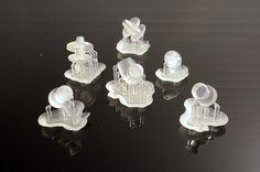 petites pièces en resine fabriquée par impression 3D. Plus d'info sur http://www.formes-et-volumes.fr/actualite.html