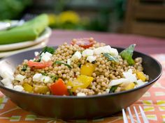 Bobby's Whole Wheat Israeli Couscous Salad: Israeli couscous has a bigger pearl than regular couscous, and it's cooked like pasta. Bobby tosses it with grilled vegetables, along with cherry tomatoes and mozzarella, dressing it all with a balsamic vinaigrette.