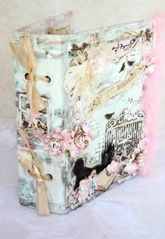 I love the eyelets and bows on the spine.