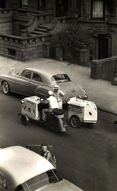 Two Ice-Cream Salesmen, The View From My Window, West 88th St., NYC, 1952 Gelatin silver print; printed c.1952 © Ruth Orkin