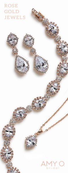 Rose Gold Bridal jewelry set. Crystal drops, teardrop necklace and statement bracelet by AMY O Bridal.