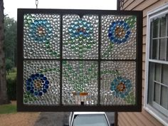 Glass nuggets glued to an old window. Looks really pretty when the sun is shining!